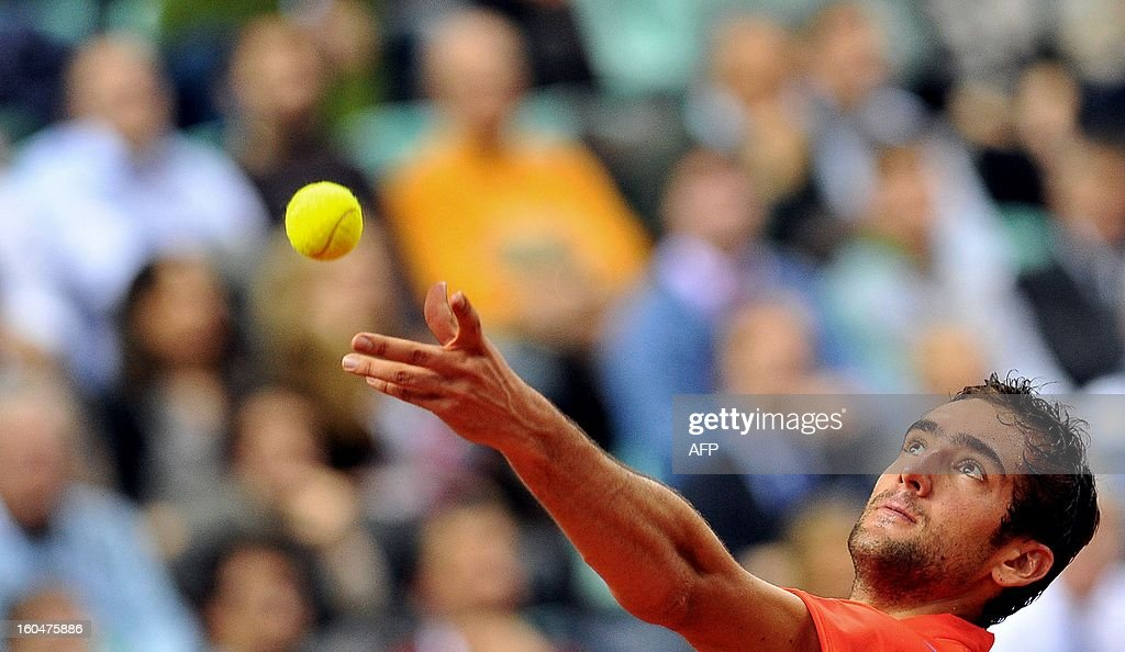 Croatia's Marin Cilic serves a ball to Italy's Paolo Lorenzi during their Davis Cup first round match on February 1, 2013 in Turin.