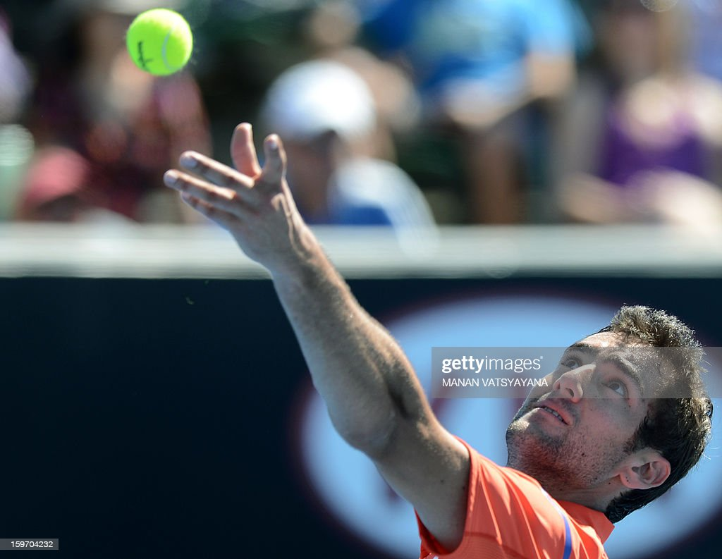 Croatia's Marin Cilic serves during his men's singles match against Italy's Andreas Seppi on the sixth day of the Australian Open tennis tournament in Melbourne on January 19, 2013. AFP PHOTO/MANAN VATSYAYANA IMAGE STRICTLY RESTRICTED TO EDITORIAL USE - STRICTLY NO COMMERCIAL USE