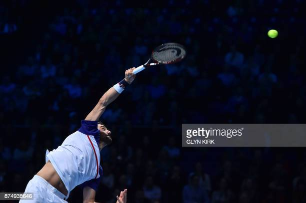 TOPSHOT Croatia's Marin Cilic serves to Switzerland's Roger Federer during their men's singles roundrobin match on day five of the ATP World Tour...