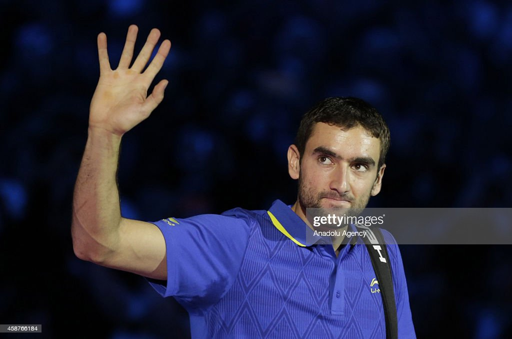 Croatia's Marin Cilic waves as he arrives for his Group A singles match against Serbia's Novak Djokovic on day two of the ATP World Tour Finals tennis tournament at O2 Arena in London, England on November 10, 2014.