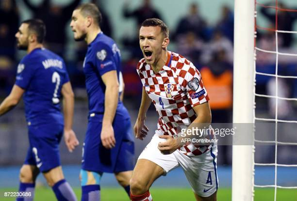 TOPSHOT Croatia's midfielder Ivan Perisic celebrates after soring a goal during the WC 2018 playoff football qualification match between Croatia and...