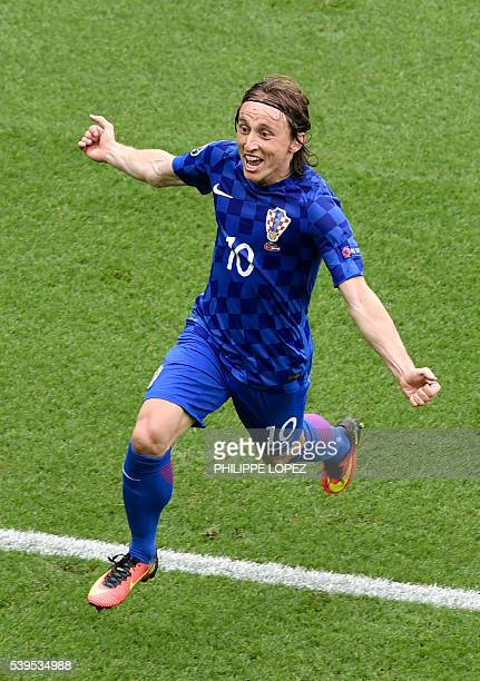 Croatia's midfielder Luka Modric celebrate the team's first goal during the Euro 2016 group D football match between Turkey and Croatia at Parc des...