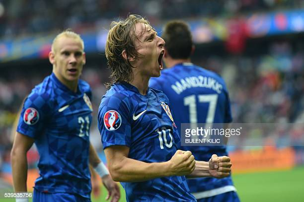 Croatia's midfielder Luka Modric celebrates a goal during the Euro 2016 group D football match between Turkey and Croatia at Parc des Princes in...
