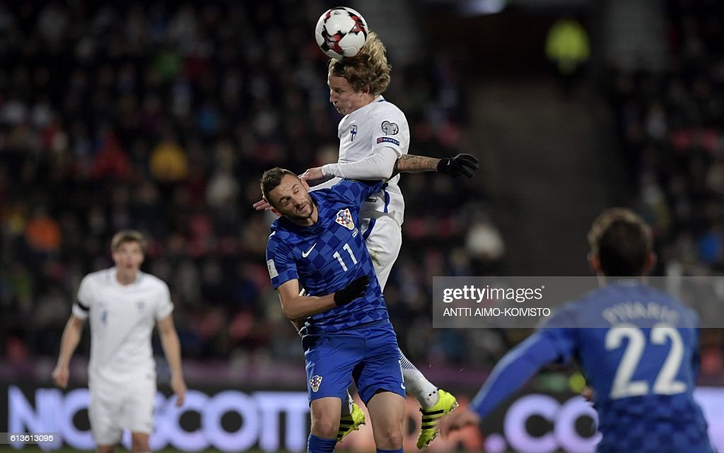 Croatia's midfielder Marcelo Brozovic (C-L) and Finland's midfielder Alexander Ring (C-R) vie for the ball during the 2018 World Cup qualifier football match of Finland vs Croatia in Tampere, Finland, on October 9, 2016. / AFP / LEHTIKUVA / Antti Aimo-Koivisto / Finland OUT