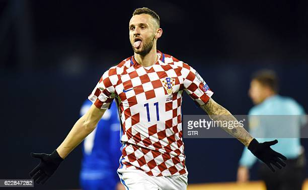 Croatia's midfielder Marcelo Brozovic celebrates after scoring a goal during the 2018 World Cup football qualification match between Croatia and...