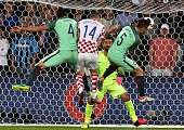 TOPSHOT Croatia's midfielder Marcelo Brozovic vies with Portugal's defender Fonte and Portugal's defender Raphael Guerreiro in front of Portugal's...