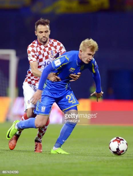 Croatia's midfielder Milan Badelj holds off Ukraine's midfielder Viktor Kovalenko during the FIFA World Cup 2018 qualifying football match Croatia vs...