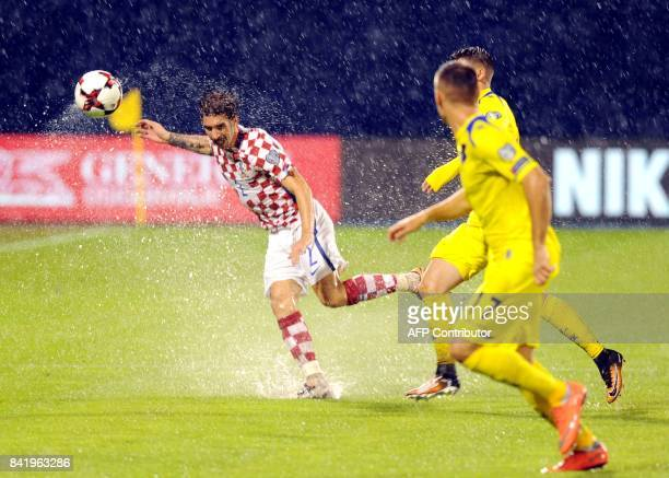 Croatia's midfielder Sime Vrsaljko fights for the ball with Kosovo's Arber Zeneli during the FIFA World Cup 2018 qualification football match between...