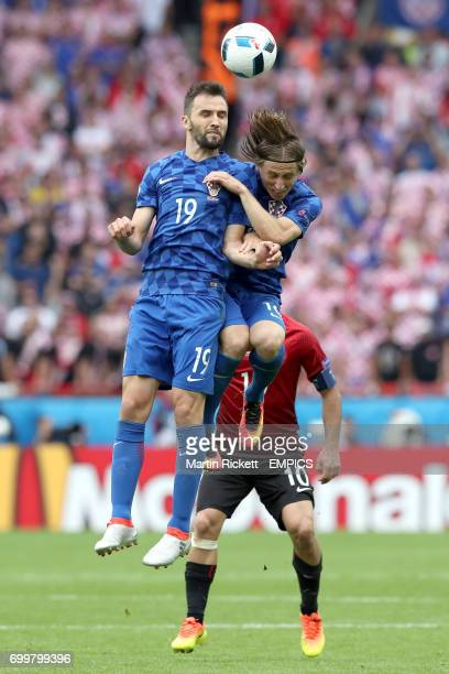 Croatia's Milan Badelj and Luka Modric challenge for the same ball