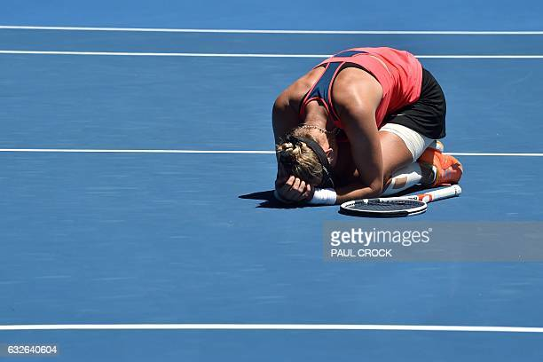 TOPSHOT Croatia's Mirjana LucicBaroni celebrates her victory against Czech Republic's Karolina Pliskova during their women's singles quarterfinal...