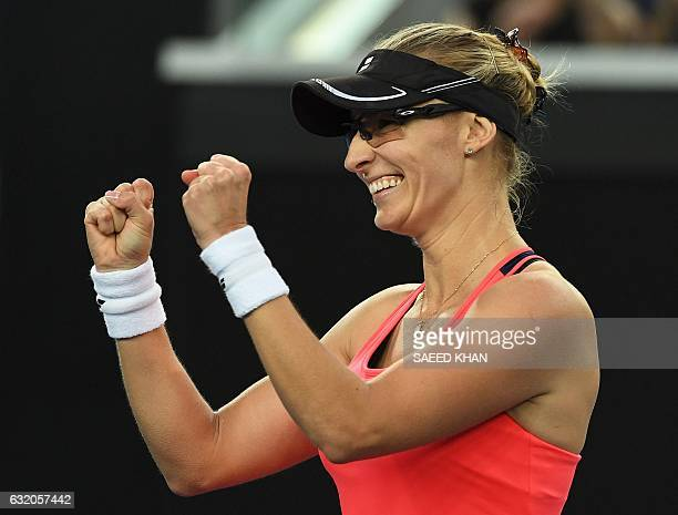 Croatia's Mirjana LucicBaroni celebrates her victory against Poland's Agnieszka Radwanska during their women's singles second round match on day four...