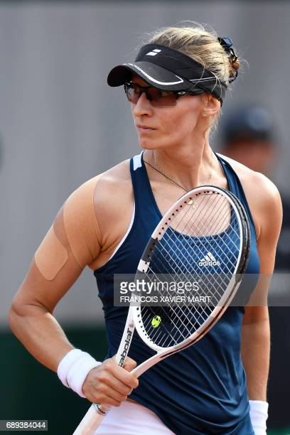 Croatia's Mirjana LucicBaroni looks on as she plays against Turkey's Cagla Buyukakcay during their tennis match at the Roland Garros 2017 French Open...