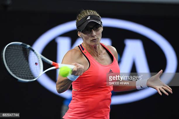 Croatia's Mirjana LucicBaroni returns a shot against Poland's Agnieszka Radwanska during their women's singles second round match on day four of the...