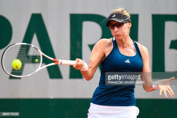 Croatia's Mirjana LucicBaroni returns the ball to Turkey's Cagla Buyukakcay during their tennis match at the Roland Garros 2017 French Open on May 28...