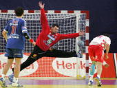 Croatia's Mirza Dzomba scores a penalty over Serbia and Montenegro goalkeeper Arpad Sterbik in front of teammate Alem Toskic during their game at the...
