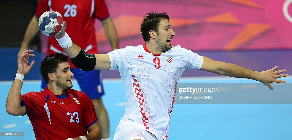 Croatia's pivot Igor Vori (R) jumps to shoot next to Serbia's Nenad Vuckovic during the men's preliminaries Group B handball match Serbia vs Croatia for the London 2012 Olympics Games on July 31, 2012 at the Copper Box hall in London.