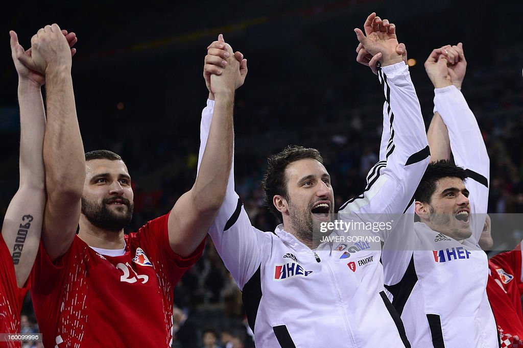 Croatia's pivot Zeljko Musa (L) and Croatia's pivot Igor Vori (C) celebrate with teammates their victory at the end of the 23rd Men's Handball World Championships bronze medal match Slovenia vs Croatia at the Palau Sant Jordi in Barcelona on January 26, 2013. Croatia won 31-26. AFP PHOTO/ JAVIER SORIANO