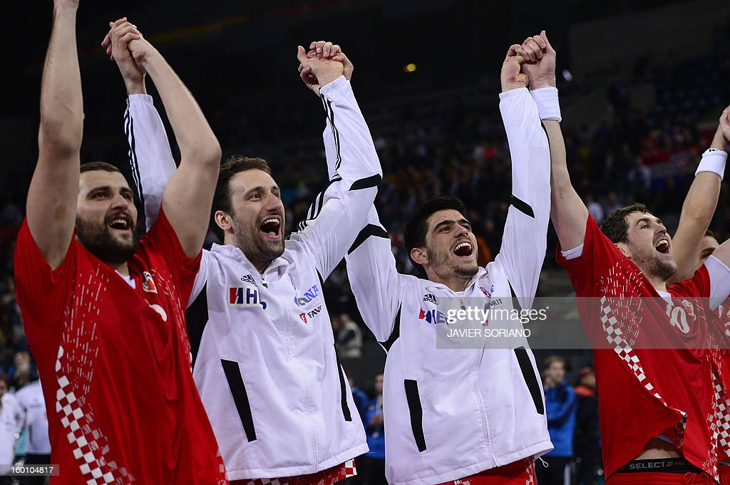 Croatia's pivot Zeljko Musa (L) and Croatia's pivot Igor Vori (C) celebrate with teammates their victory at the end of the 23rd Men's Handball World Championships bronze medal match Slovenia vs Croatia at the Palau Sant Jordi in Barcelona on January 26, 2013. Croatia won 31-26.