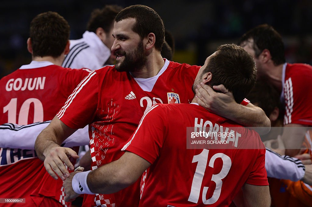 Croatia's pivot Zeljko Musa (L) celebrates their victory at the end of the 23rd Men's Handball World Championships bronze medal match Slovenia vs Croatia at the Palau Sant Jordi in Barcelona on January 26, 2013. Croatia won 31-26. AFP PHOTO/ JAVIER SORIANO