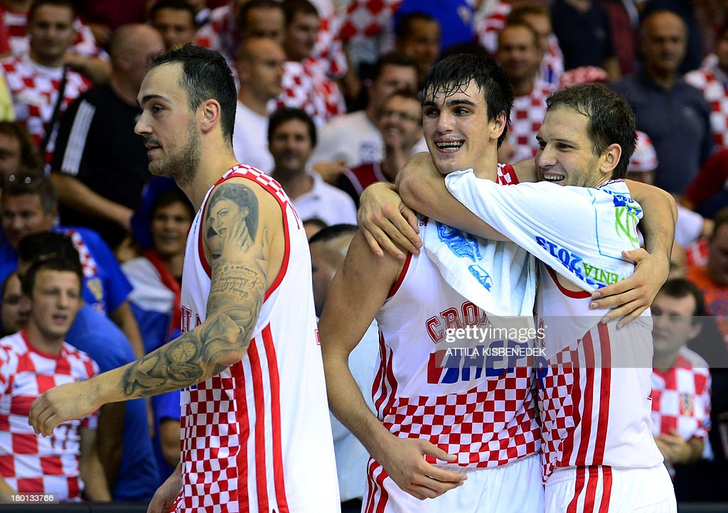 Croatia's players celebrate after winning the Eurobasket 2013 championships qualifying basketball match Croatia vs Czech Republic in Celje on...