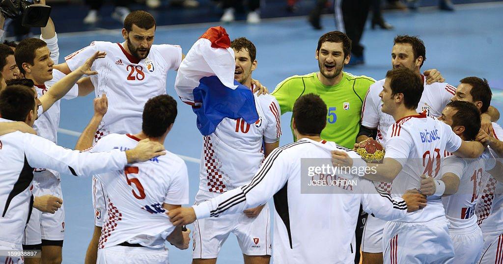 Croatia's players celebrate at the end of the 23rd Men's Handball World Championships quarterfinal match France vs Croatia at the Pabellon Principe...