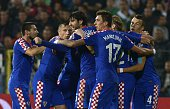 Croatia's players celebrate the own goal of Bulgaria during the Euro 2016 group H qualifying football match between Bulgaria and Croatia at the...