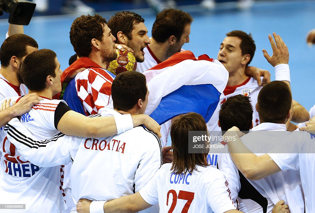 Croatia's players celebrate their victory at the end of the 23rd Men's Handball World Championships quarterfinal match France vs Croatia at the...