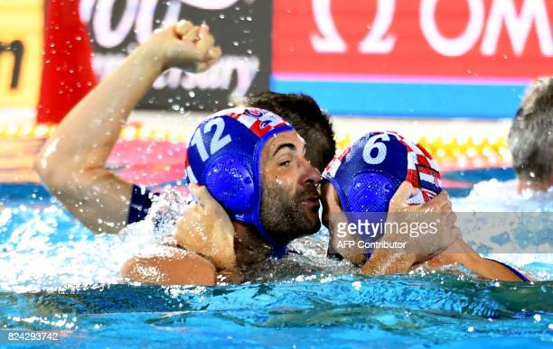 Croatia's players celebrate their victory over Hungary in 'Hajos Alfred' swimming pool of Budapest on July 29 2017 after the men final of FINA2017...