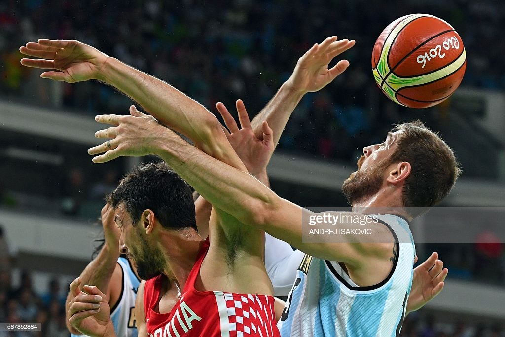 TOPSHOT Croatia's point guard Roko Ukic and Argentina's small forward Andres Nocioni go for a rebound during a Men's round Group B basketball match...