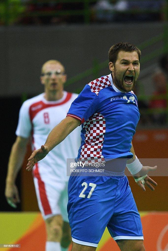 Croatia's right back Ivan Cupic celebrates a goal during the men's quarterfinal handball match Croatia vs poland for the Rio 2016 Olympics Games at...