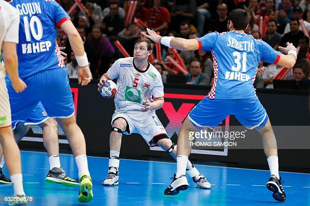 Croatia's right back Luka Sebetic defends against Norway's centre back Sander Sagosen during the 25th IHF Men's World Championship 2017 semifinal...