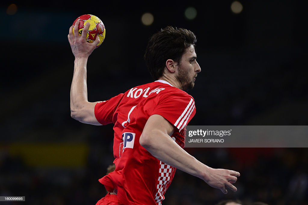 Croatia's right back Luka Stepancic shoots during the 23rd Men's Handball World Championships bronze medal match Slovenia vs Croatia at the Palau Sant Jordi in Barcelona on January 26, 2013. AFP PHOTO/ JAVIER SORIANO