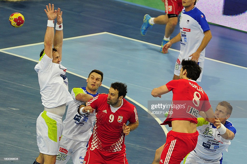 Croatia's right back Marko Kopljar (2ndR) shoots during the 23rd Men's Handball World Championships bronze medal match Slovenia vs Croatia at the Palau Sant Jordi in Barcelona on January 26, 2013. AFP PHOTO/ JOSEP LAGO