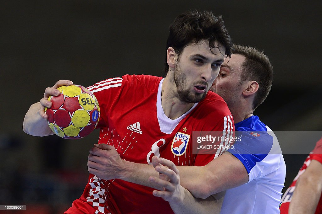Croatia's right back Marko Kopljar (L) vies for the ball during the 23rd Men's Handball World Championships bronze medal match Slovenia vs Croatia at the Palau Sant Jordi in Barcelona on January 26, 2013. AFP PHOTO/ JAVIER SORIANO