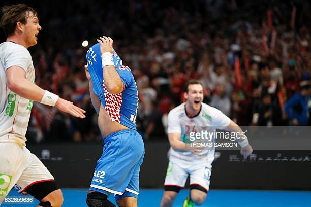 Croatia's right back Zlatko Horvat covers his face with his jersey after failing to score a last second penalty as Norway's centre back Christian...