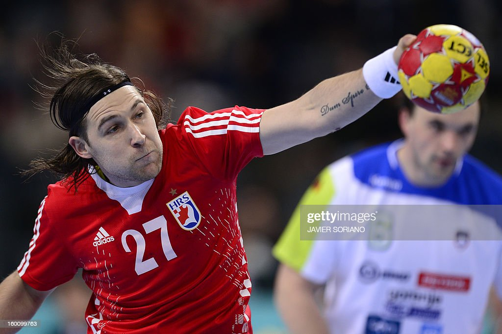 Croatia's right wing Ivan Cupic shoots during the 23rd Men's Handball World Championships bronze medal match Slovenia vs Croatia at the Palau Sant Jordi in Barcelona on January 26, 2013