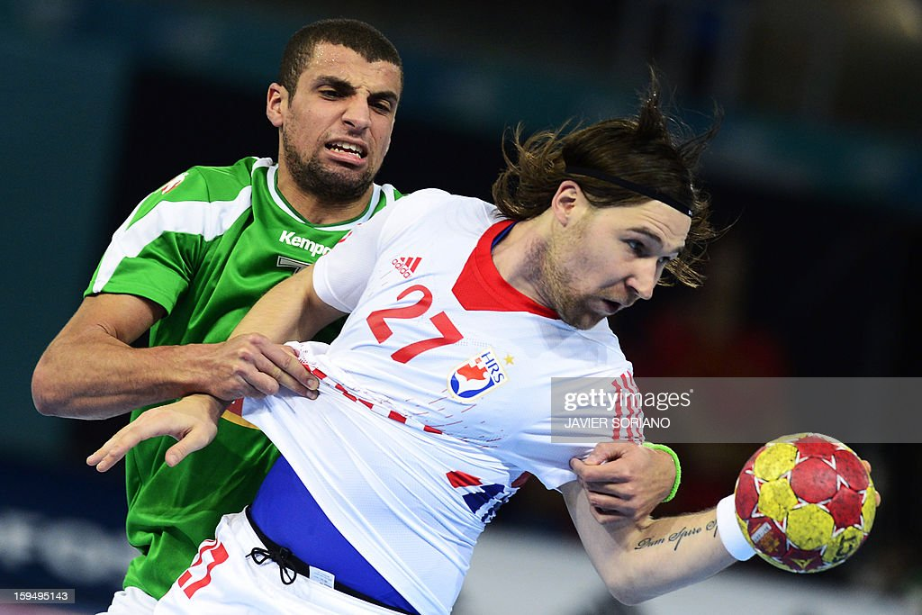 Croatia's right wing Ivan Cupic (R) vies with Algeria's centre back Hichem Daoud (R) during the 23rd Men's Handball World Championships preliminary round Group D match Algeria vs Croatia at the Caja Magica in Madrid on January 14, 2013. Croatia won 30-20.