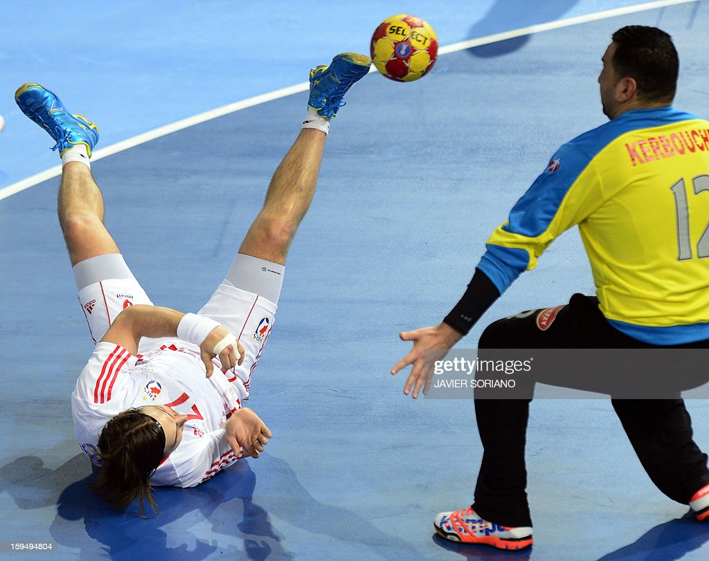 Croatia's rightwing Ivan Cupic (L) shoots in front of Algeria's goalkeeper Samir Kerbouche (R) during the 23rd Men's Handball World Championships preliminary round Group D match Algeria vs Croatia at the Caja Magica in Madrid on January 14, 2013. AFP PHOTO/ JAVIER SORIANO