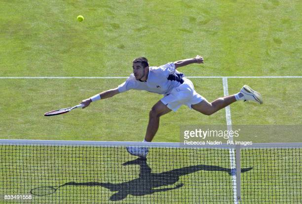 Croatia's Roko Karanusic in action against Andy Murray during the third day of the Davis Cup World Group Playoff at the All England Club Wimbledon