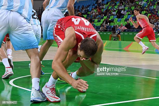 TOPSHOT Croatia's shooting guard Bojan Bogdanovic holds his face after being injured during a Men's round Group B basketball match between Argentina...