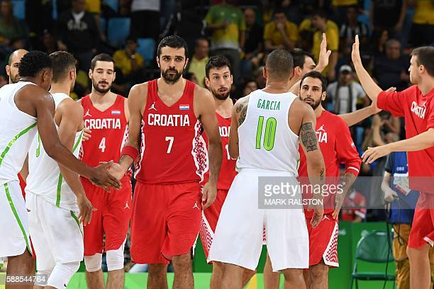 Croatia's shooting guard Krunoslav Simon shakes hand with Brazil's shooting guard Leandro Barbosa after a Men's round Group B basketball match...