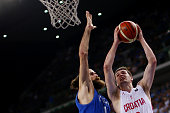Croatia's shooting guard Mario Hezonja tries to score past Italy's small forward Luigi Datome during the final match of the Olympic Qualifying...
