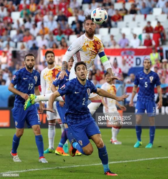 Croatia's Sime Vrsaljko and Spain's Sergio Ramos battle for the ball