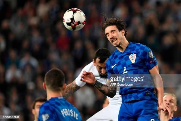 Croatia's Sime Vrsaljko heads the ball during the World Cup 2018 playoff football match Greece vs Croatia on November 12 2017 in Piraeus / AFP PHOTO...