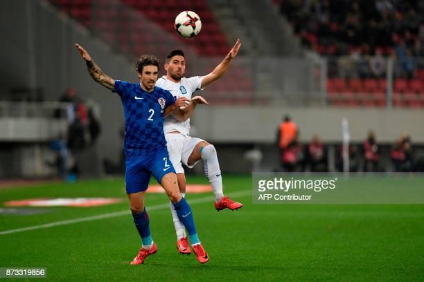 Croatia's Sime Vrsaljko vies with Greece's Anastasios Bakasetas during the World Cup 2018 playoff football match Greece vs Croatia on November 12...