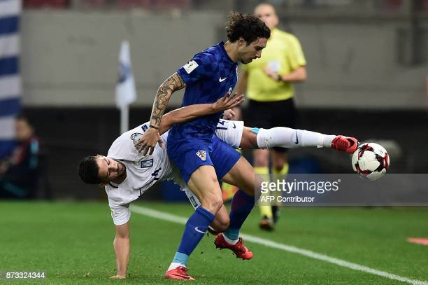 Croatia's Sime Vrsaljko vies with Greece's Anastasios Bakasetas during the World Cup 2018 playoff football match Greece vs Croatia on November 12...