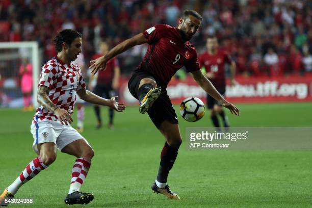 Croatia's Sime Vrsaljko vies with Turkey's Cenk Tosun during the FIFA World Cup 2018 qualifying football match between Turkey and Croatia in...