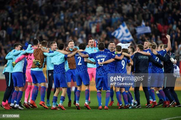 Croatia's team celebrates after winning the World Cup 2018 playoff football match Greece vs Croatia on November 12 2017 in Piraeus / AFP PHOTO /...