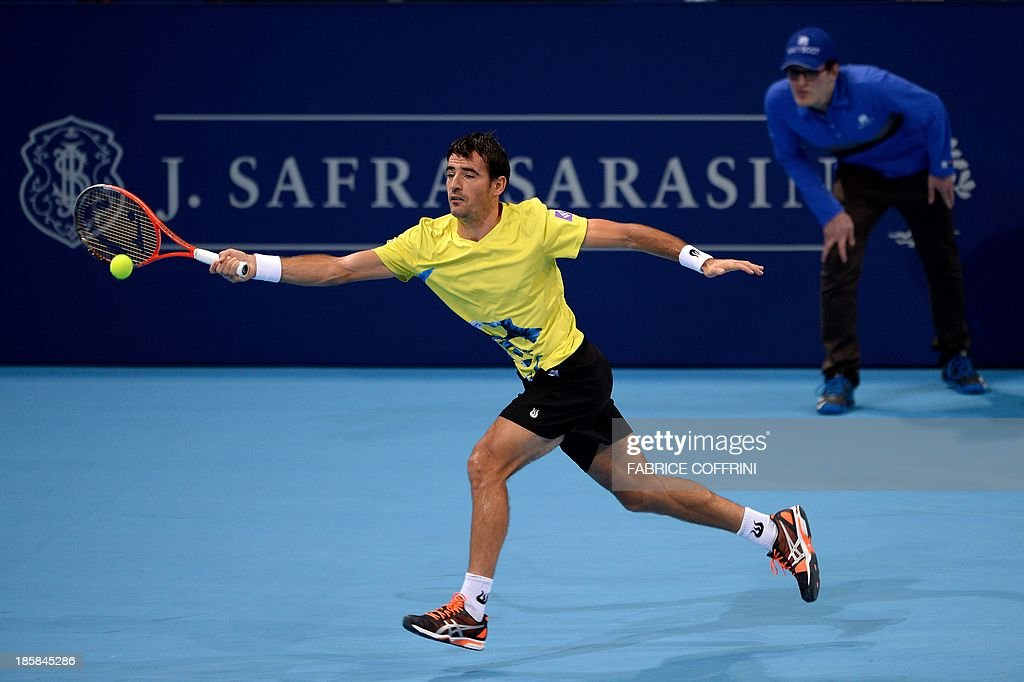 Croatia's tennis player Ivan Dodig returns a ball during his quarter final match against Canada's Vasek Pospisil at the Swiss Indoors ATP tennis tournament on October 25, 2013 in Basel.
