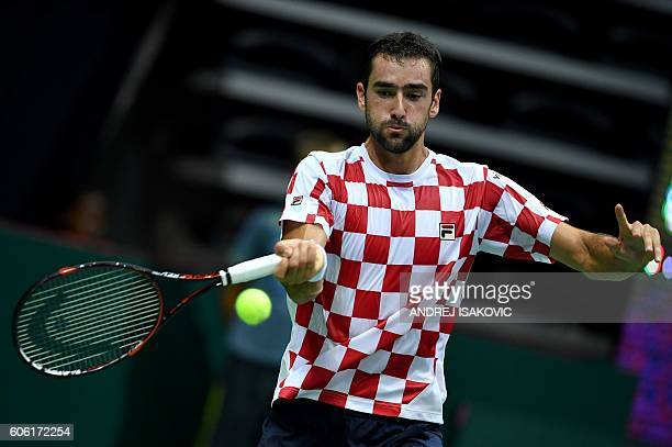 Croatia's tennis player Marin Cilic returns the ball to France's Lucas Pouille during the Davis Cup World Group semifinal single match between...